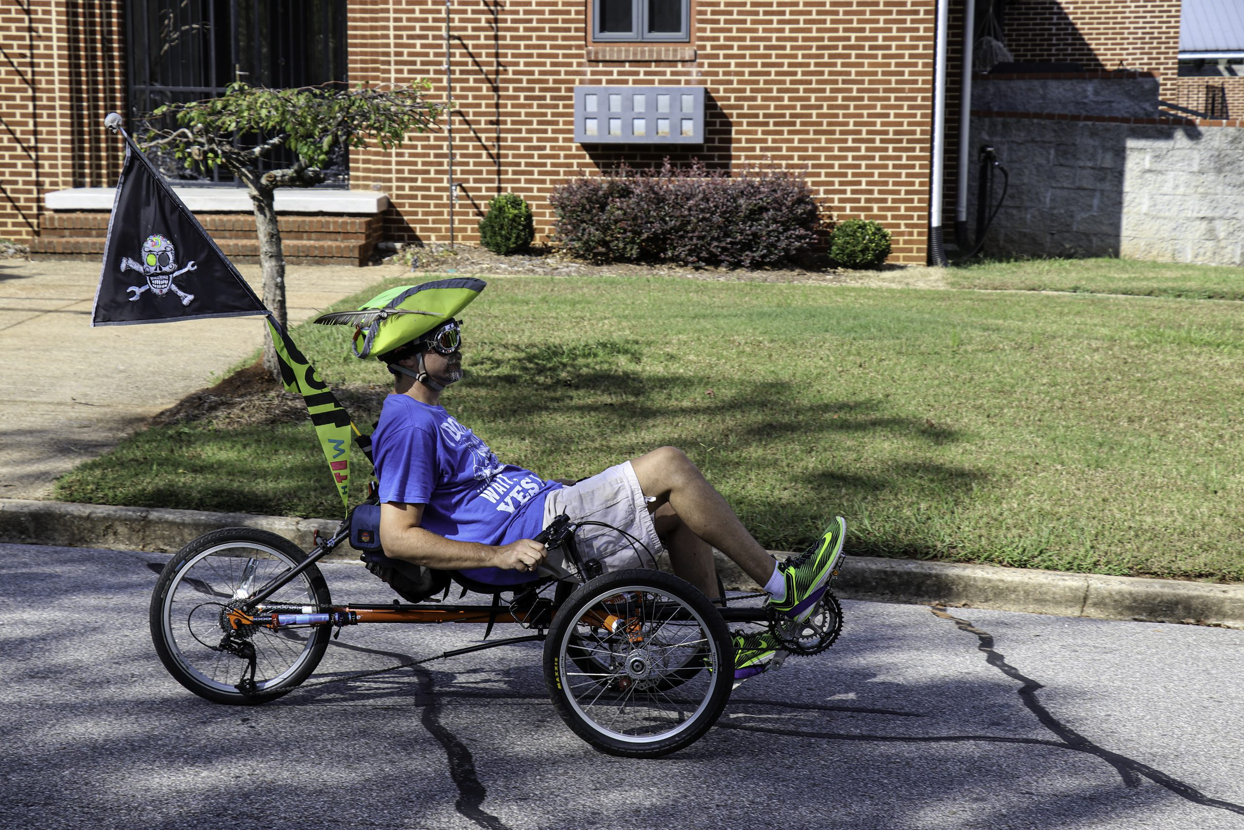 Athens, Georgia - October 15, 2017: A man on a recumbent tricycle rides dressed as a pirate during Boo-le-Bark on the Boulevard, an annual community parade and fundraiser for the Athenspets non-profit.